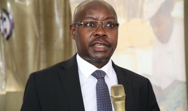 Mr. Pius Wakabi Kasaijja, The Permanent Secretary, Ministry of Agriculture, Animal Industry and Fisheries (MAAIF) behind a stand speaking at the launch of the CABI BioProtection Portal in Uganada