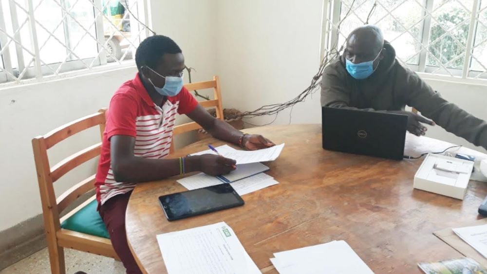 One of the participants being taken through the user testing session in Nakuru, Kenya.
